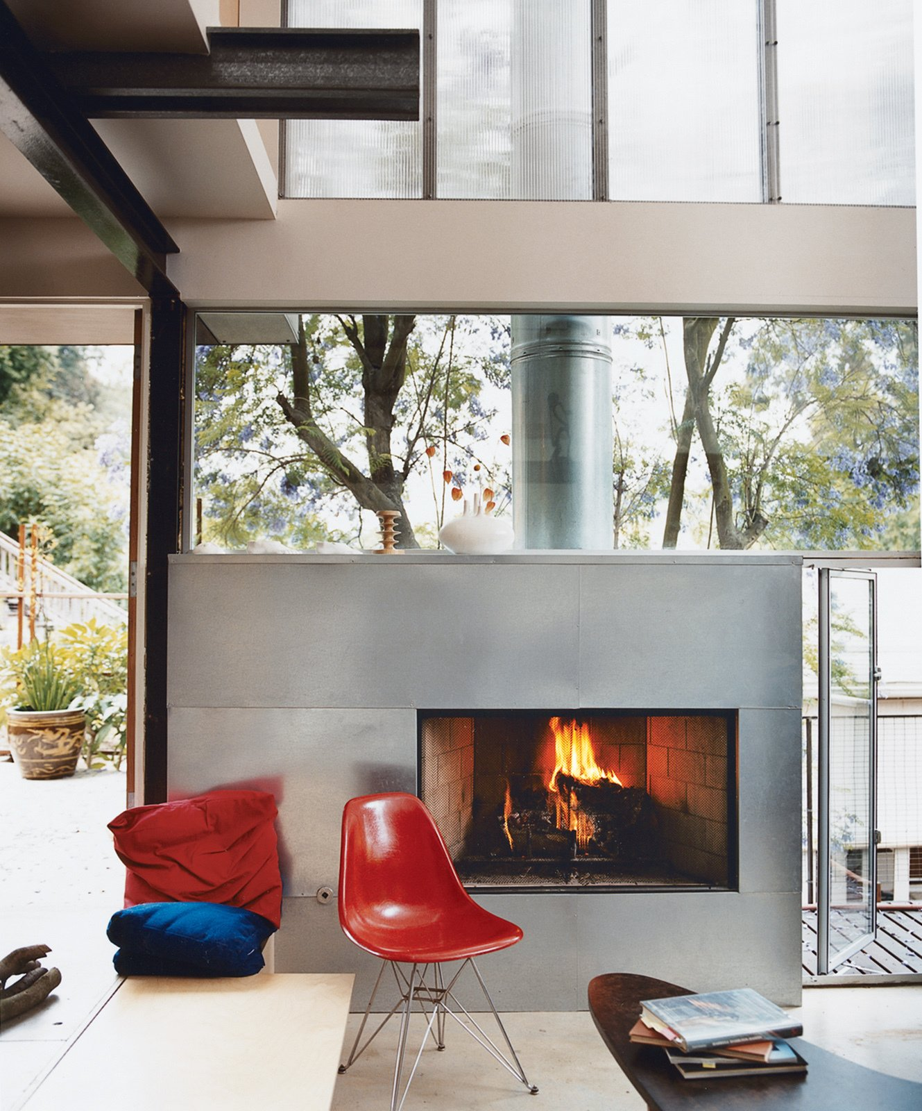 Living Room, Corner Fireplace, Wood Burning Fireplace, Coffee Tables, Chair, and Bench  97+ Modern Fireplace Ideas from Eames Molded Chairs