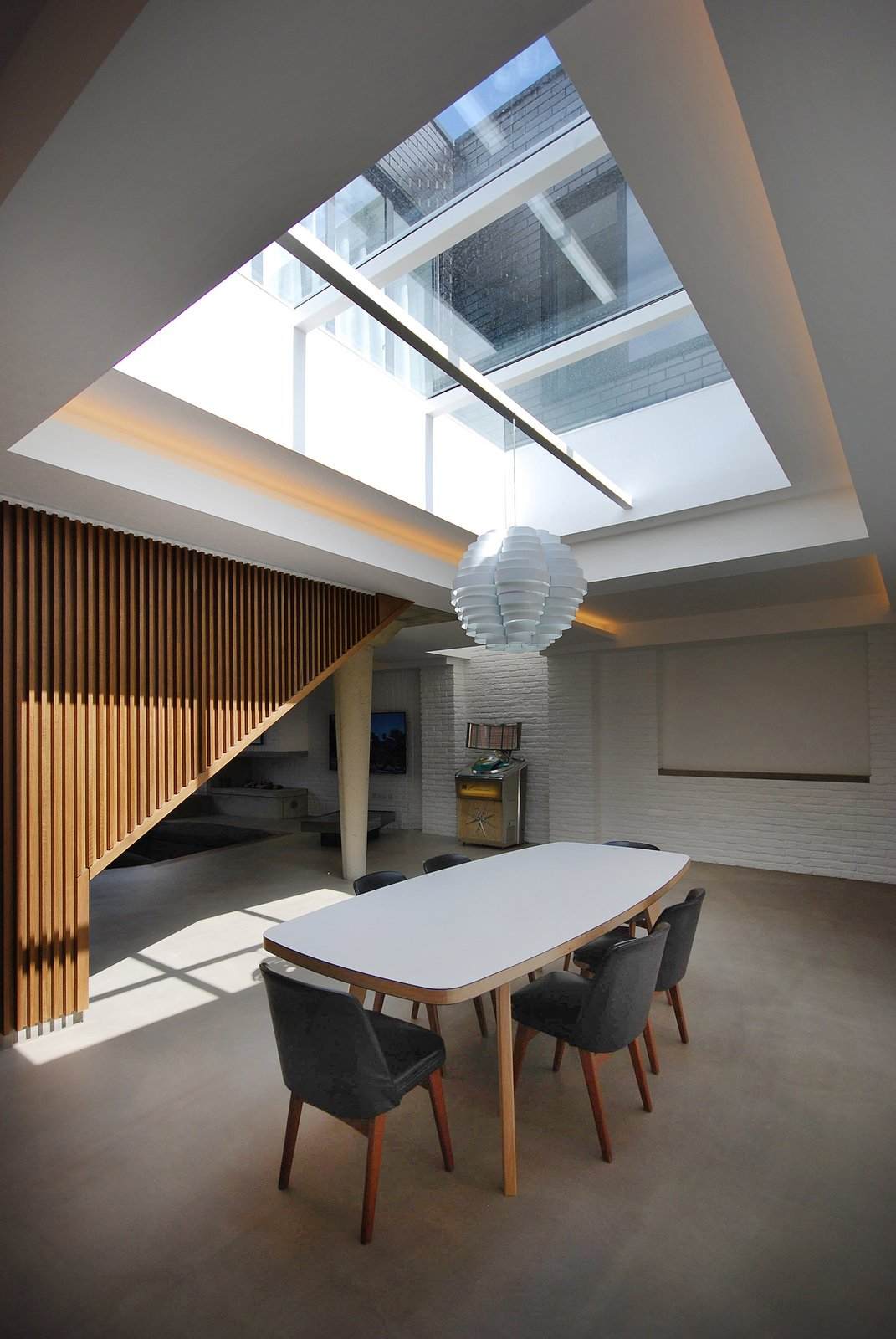 #interior #dining #modern #table #diningarea #naturallighting #skylight #london #jamesburleigh #brick #industrial #woodwall   Photo 12 of 20 in Pull Up a Chair in One of These 20 Modern Dining Rooms from Dining
