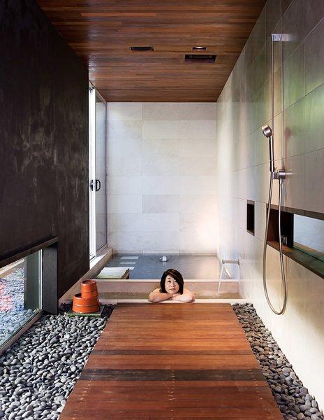 Bath Room #modern #moderndesign #bath&spa #bathroom #interior #shower #pebblewalkway #bath #japanese #japanesestyle #soakingtub #woodflooring #dornbracht   Photo 20 of 22 in Bath & Spa Intrigue