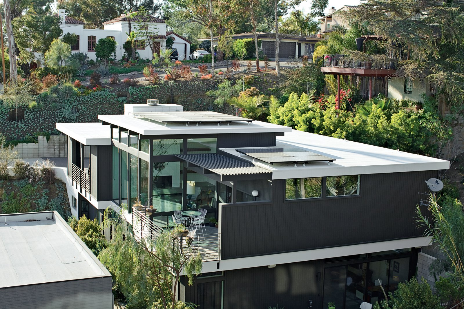 Exterior, House Building Type, Wood Siding Material, Flat RoofLine, Green Roof Material, and Glass Siding Material The Shayan House takes full advantage of its canyon site.  Photo 3 of 13 in The First LEED Gold-Certified Family Home in San Diego