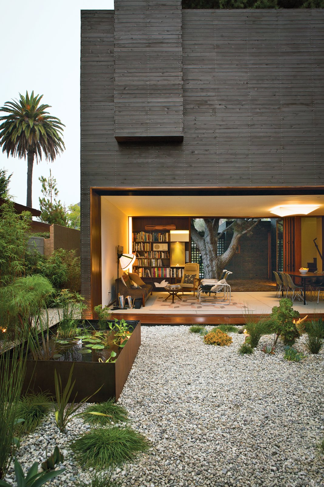 Outdoor, Gardens, Back Yard, Trees, Walkways, Hardscapes, and Garden Architectural designer Sebastian Mariscal and project manager Jeff Svitak created a house in Venice, California, for Michael and Tamami Sylvester. Known as Dwell Home Venice for its role as an exemplification of modern architecture, the house is an homage to indoor-outdoor living. Photo by Coral von Zumwalt.  Photo 1 of 7 in Sebastian Mariscal's Wood Architecture from A Modern Bungalow in Venice Beach