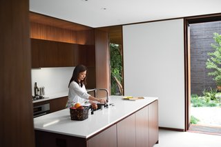 "A Modern Bungalow in Venice Beach - Photo 4 of 10 - ""I love the house more each day,"" says Tamami Sylvester of her and husband Michael's home by Sebastian Mariscal in Venice, California. The kitchen, which includes all Miele appliances, is sheathed in custom woodwork from Semihandmade. Accessories from A+R complement the Caesarstone countertops and Franke faucet. A LifeSource Water System provides filtration. Photo by Coral von Zumwalt."
