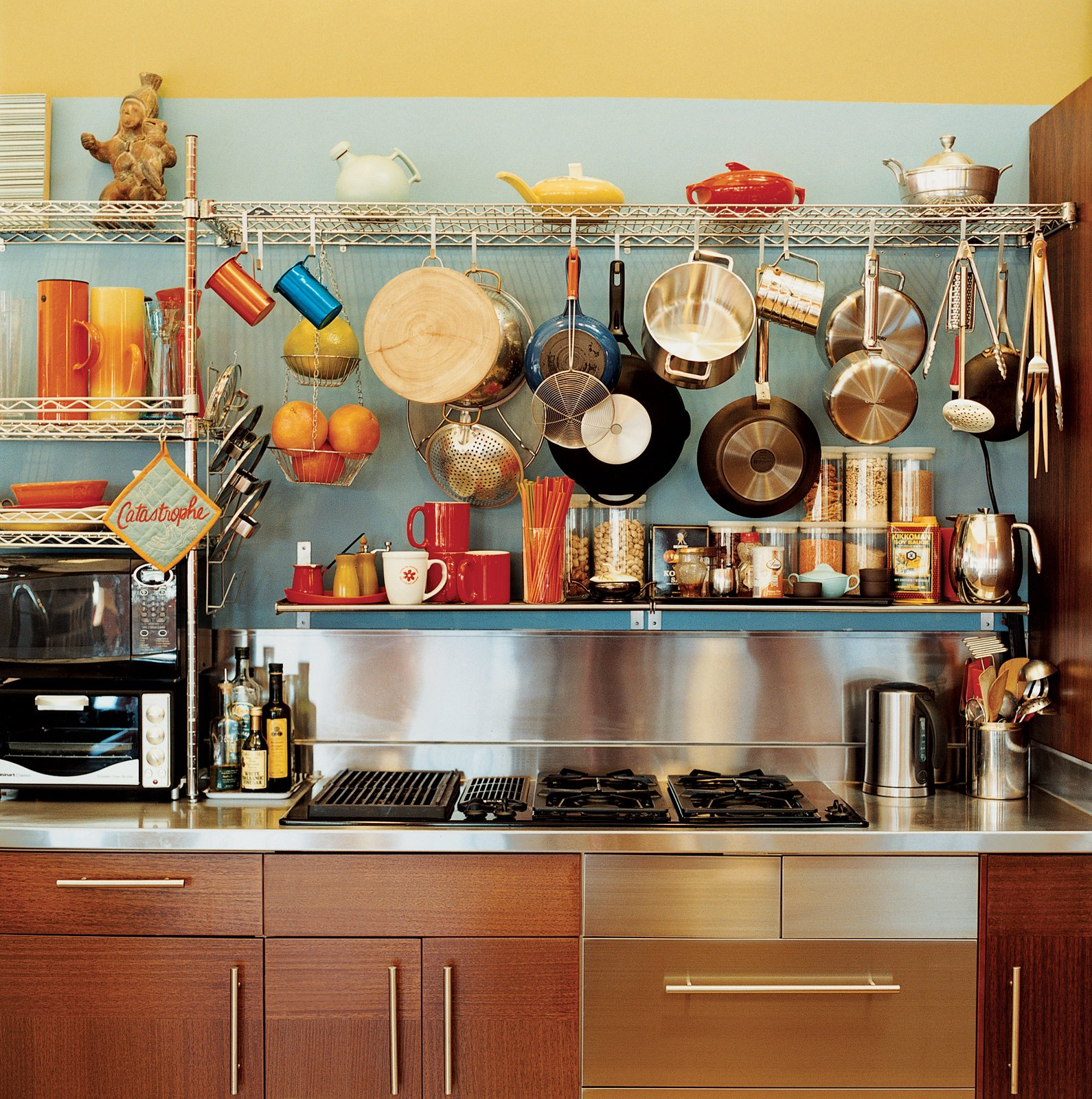 Kitchen and Cooktops Vintage kettles and a wide-ranging assortment of pots and pans sit above kitchen cabinets from IKEA.  Photo 5 of 10 in Sun Mun Way Cool