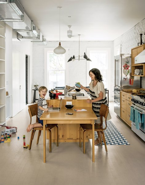 """Kitchen & Dining Room<br><br>""""This room really became the heart of the space,"""" Dawn Casale says. """"If people are sitting at the dining table or in the living area, you're able to have a really free-flowing conversation and there's a nice dynamic happening on the entire floor."""""""