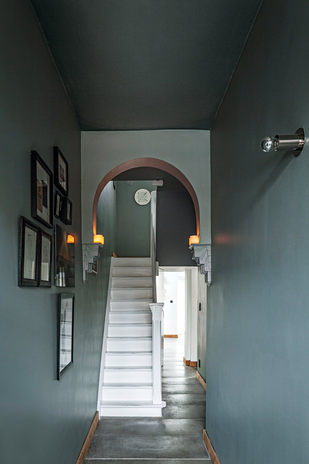 The couple retained the strongest architectural aspects of the house, such as the existing arch in the hall, and did away with others, such as a previous kitchen renovation.  Photo 5 of 8 in A Clever Belgian Couple Renovate Their Aging Brick Home