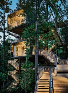 Architecture firm Mithun designed the tree house so that it would tread lightly on the land. The firm originally considered prefabricating the entire structure offsite but, in the research process, concluded that craning large modules into place would potentially harm the canopy. A combination of a bolted-together prefab structure and site-built wood housing yielded the least intrusive construction option.