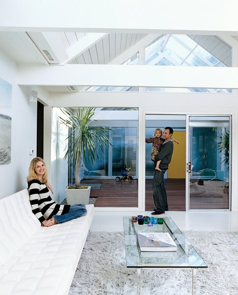 """""""We're trying to pretend this is our little ray of sunshine in the middle of Portland,"""" says Jennifer, with Mattias and Moa (right), of the couple's Eichleresque abode. The sofa is by Florence Knoll for Knoll."""