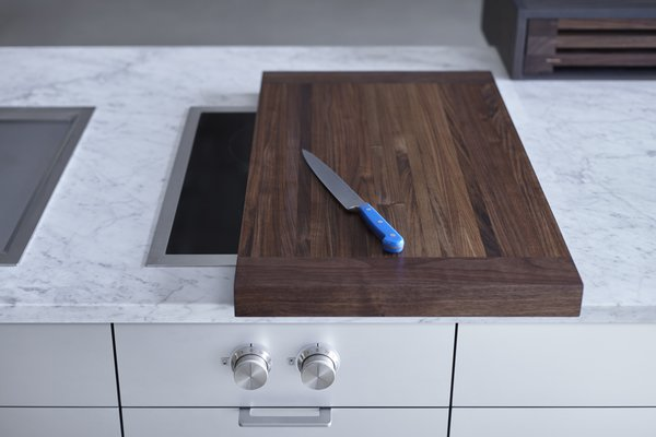 After just one day of using the kitchen, the team realized that they could design special cutting boards that slide on and off the Gaggenau modular cooking units. This way, they'd be extending the amount of usable counter space while introducing a whole new level of customization. They made it happen that same night.