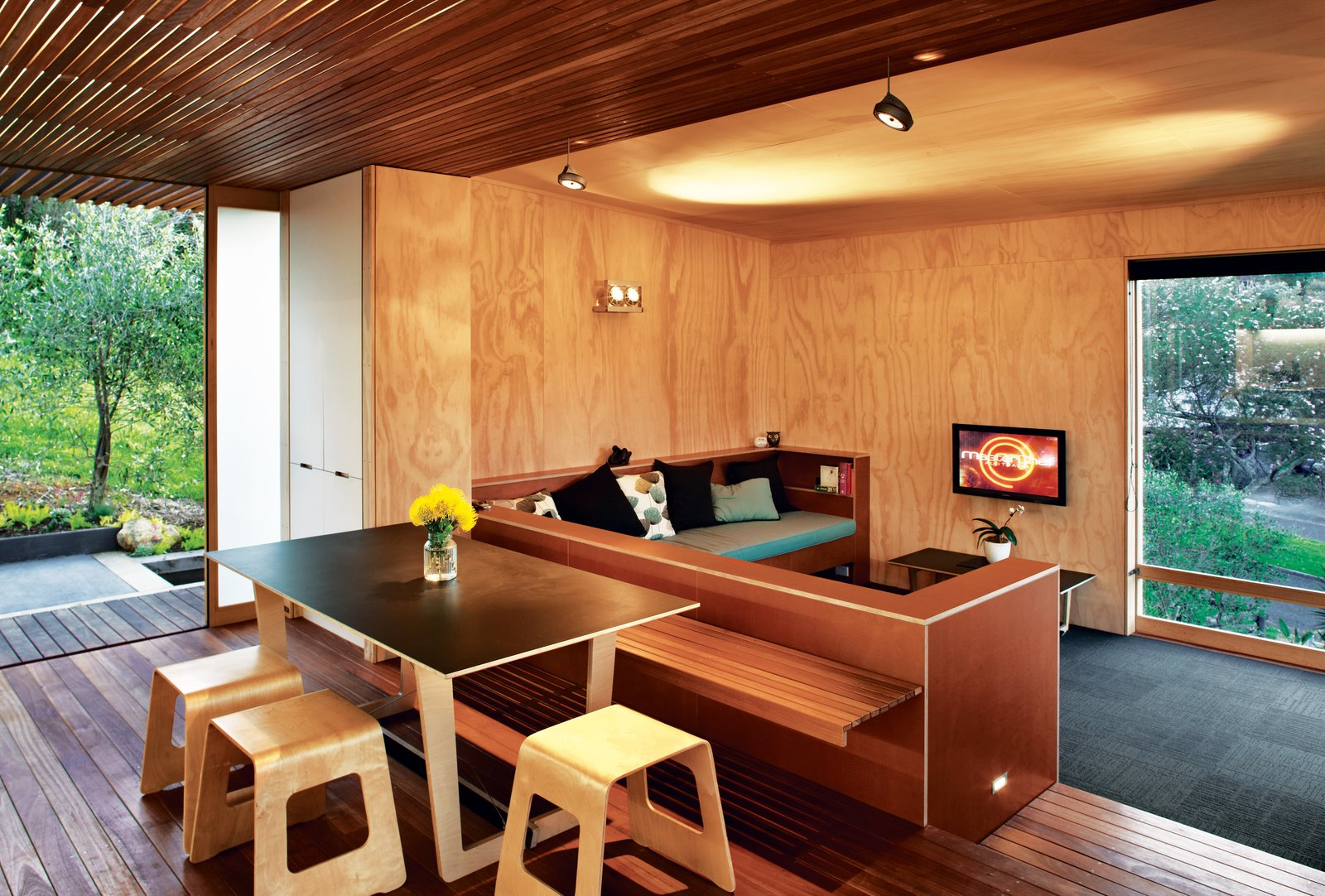 Designer Tim Webber created the dining table and stools.  Photo 5 of 7 in A Compact Prefab Vacation Home