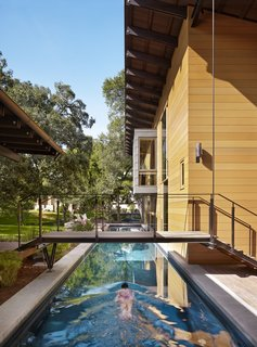 """16 Boxy Modern Pools For This Summer - Photo 11 of 16 - """"The owners envisioned a place that engaged with the outdoors while providing accommodating spaces for their off-season training for triathlons,"""" Flato notes. A 75-foot-long lap pool on the west end of the home comes in handy during practice."""