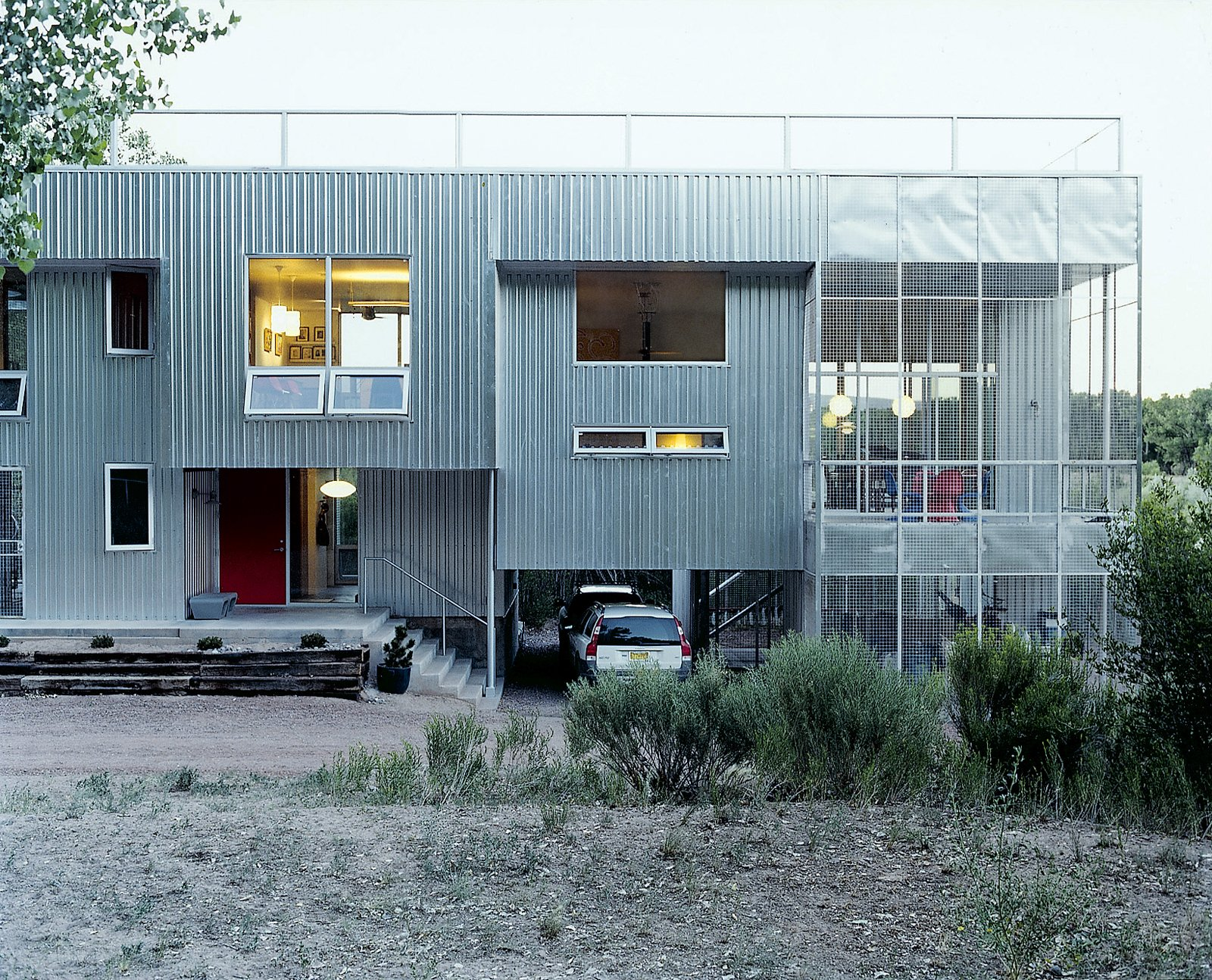 Outdoor and Shrubs Thanks to passive solar and radiant floors, the metal-clad home is comfortable year-round.  Photo 2 of 10 in Abiquiu Debut
