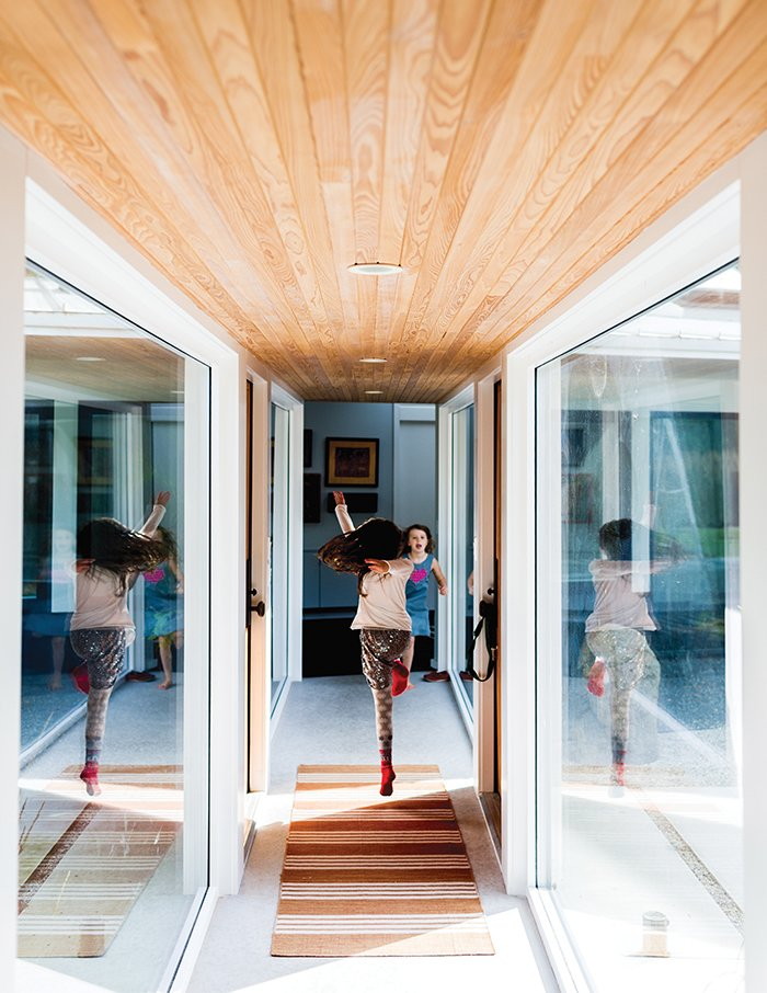 """""""I believe that the interior of a home is a personal choice of color and furnishings, and an expression of the people that live there,"""" says resident Julie Brogan. Tagged: Hallway.  Photo 5 of 8 in A Modern Lakeside Home in Wisconsin"""