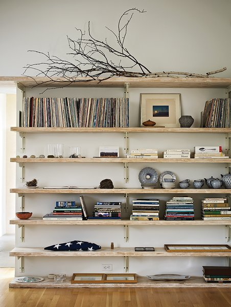 Built-in bookshelves in the living room hold Sanders's vinyl collection.