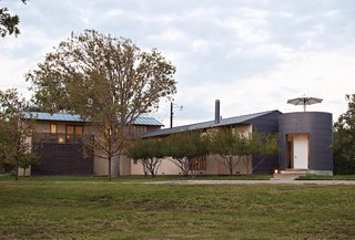 """A Light-Filled, Nature-Inspired House in Dallas - Photo 9 of 9 - """"One of the things Max insisted on,"""" Sanders says, """"was that we have views of our own house. That's why all the sides of the house are different."""" Some are stucco, others are metal-clad, and ipe latticework encloses one end of the garage."""