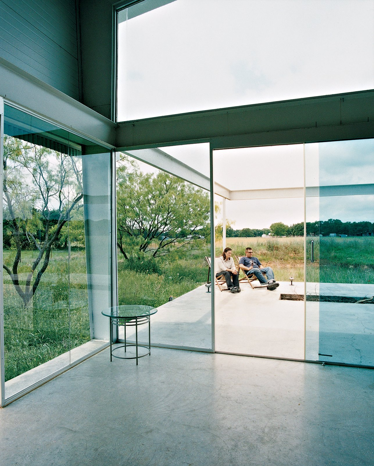 Doors, Sliding Door Type, Metal, and Exterior A continuous concrete slab runs from inside the house out to the open deck, which is exposed to the wind that sweeps the surrounding fields.  Photo 4 of 13 in Lone Star