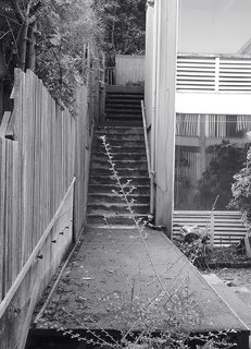 A Home's Past Mistakes Are Finally Corrected - Photo 11 of 14 - The original exterior had Astroturf-covered stairs.