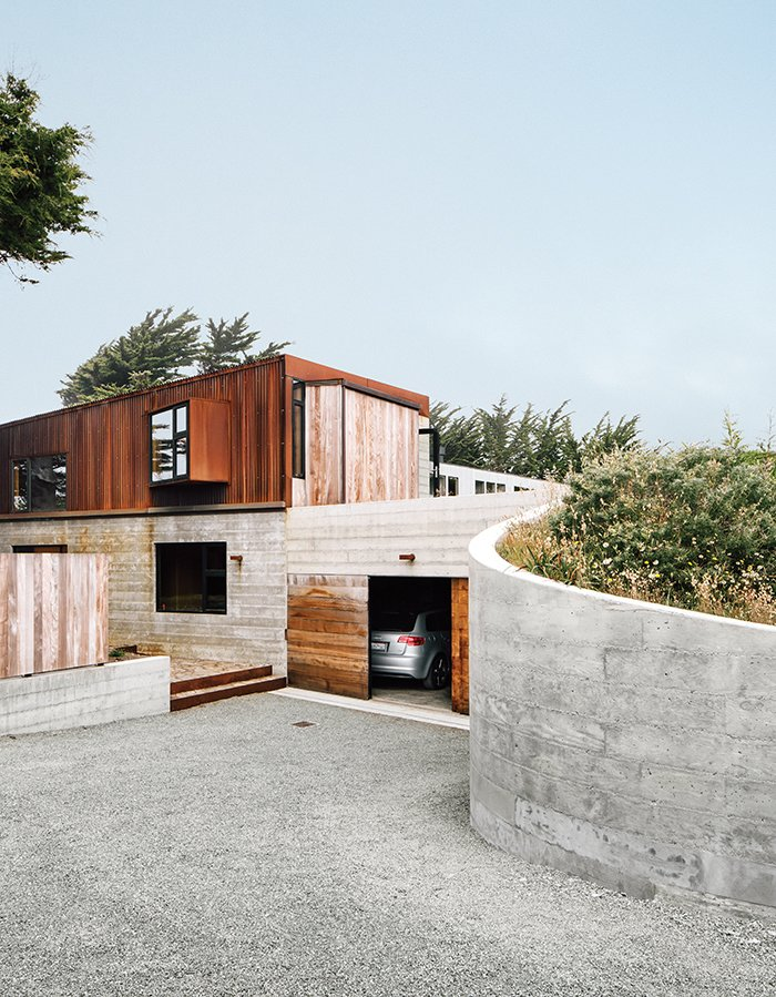 Cor-Ten steel and board-form concrete give the exterior a weathered look. Tagged: Exterior, House, Concrete Siding Material, Metal Siding Material, and Shed RoofLine.  Photo 6 of 9 in Modern Home Joins a Storied Site on the Pacific Ocean