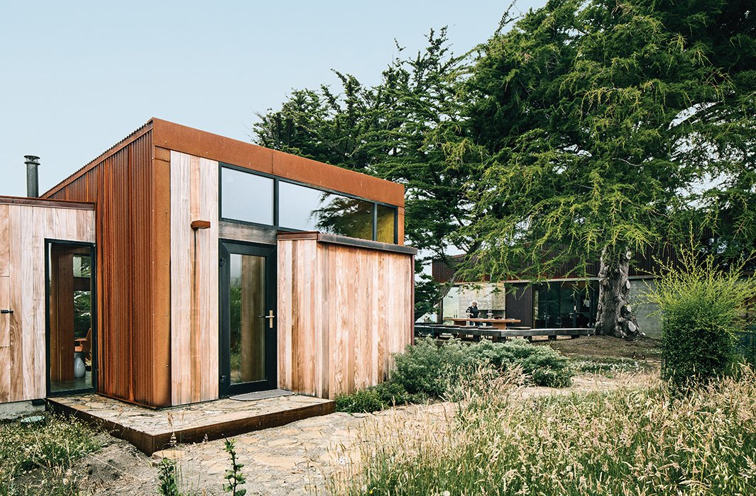 Sea caves on the property forced the architects to split some of the living space into a 483-square-foot guesthouse. Tagged: Shed & Studio and Living Space.  Photo 5 of 9 in Modern Home Joins a Storied Site on the Pacific Ocean