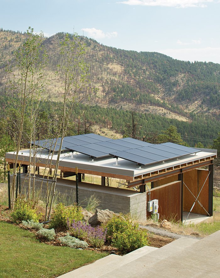 The Solar Revolution installed 3.6-kilowatt photovoltaic solar panels on top of the carport, which sports a board-formed concrete exterior and a cedar-slat-and-plywood interior. Tagged: Exterior, Flat RoofLine, and House.  Photo 2 of 7 in Sustainable Retreat on a Fire-Devastated Site in Boulder