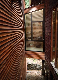 Clapboard siding prevents wind and rain from entering a building by overlapping the tapered boards.