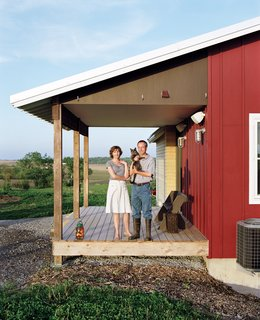 Geoff and Joanna Mouming's compact modern farmhouse is the first permanent structure at Yum Yum Farm in Wellman, Iowa. On the field that stretches out before it, organic vegetables will soon make attentive farmers of the Moumings. The benches on their entry porch were built by Geoff using a design plan by Aldo Leopold, the pioneering Iowa-born conservationist and writer whose spirit and thoughts seem to preside over the house.