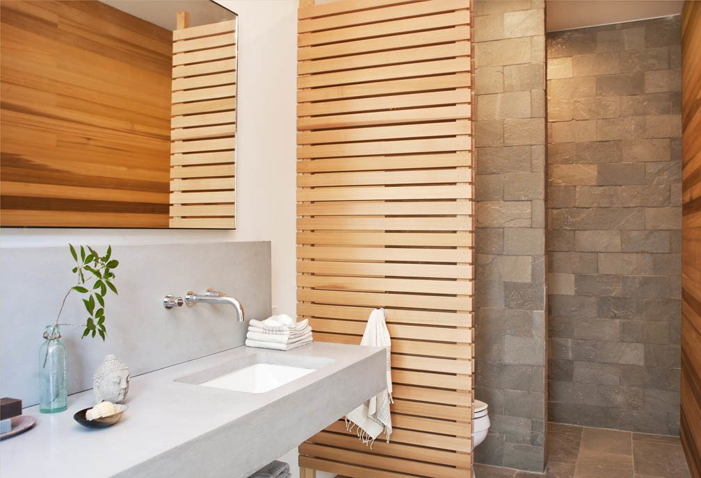 Bath Room and Undermount Sink The master bathroom features a cedar screen and quartzite tiles by Walker Zanger.  Photo 8 of 10 in An Enclave of Modern Cottages in New York's Hudson Valley