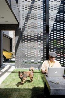 David Hernandez and Jack enjoy the house's walled garden.