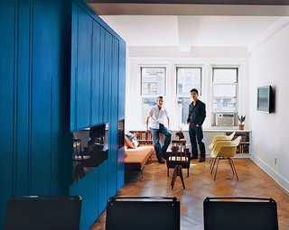 Eric Schneider and Michael Chen take in their space-efficient renovation. Small spaces don't necessarily need to curtail decoration. Interior designer Nicole Sassamanon added the finishing touches here.