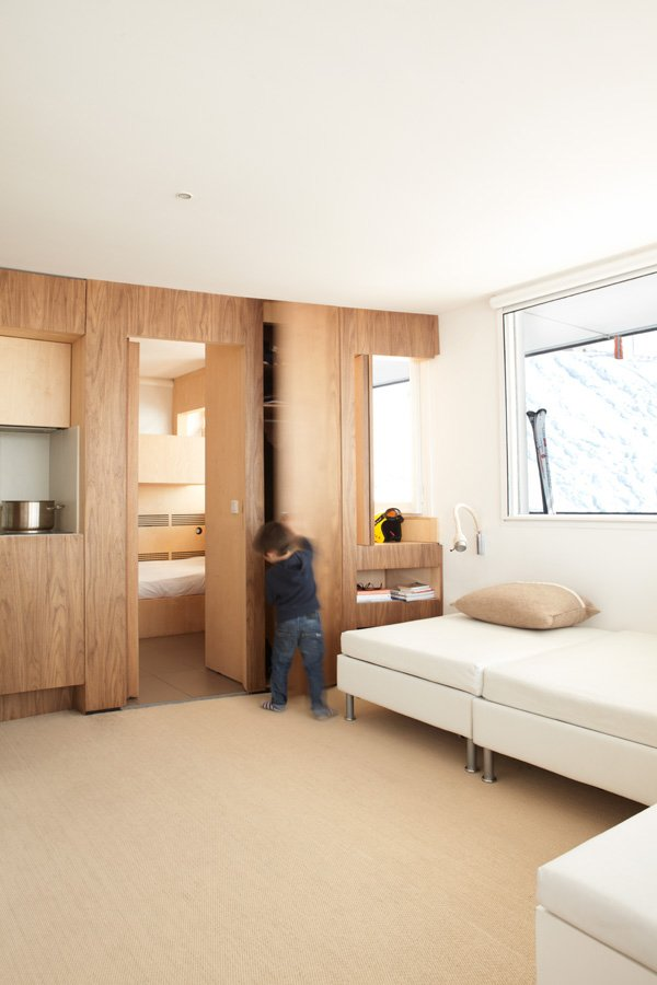 Panels slide open to connect the spaces, or closed for privacy. The bed beneath the window is by Swiss company Bico folds into a couch during the day.  Photo 7 of 8 in 8 Modern Paneled Rooms