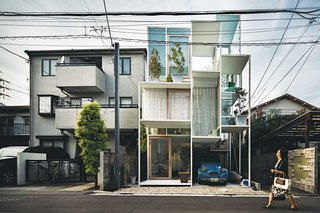 House NA from 2011 has glass walls and a steel structural frame containing a matrix of tiny rectangular rooms and outdoor terraces, each on a separate floor level linked by stairs, ladders, or movable steps. Hemmed in by neighboring homes on three sides and a narrow street in front, the house belongs to a couple clearly at ease with Tokyo's urban condition.