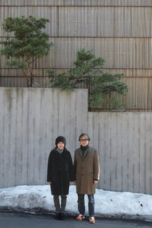 Seoul, South Korea - Photo 2 of 13 - Architect Byoung-soo Cho and his wife, Eunsil Kim, value the privacy, and style, that a concrete wall and recycled Indonesian teak facade provide.