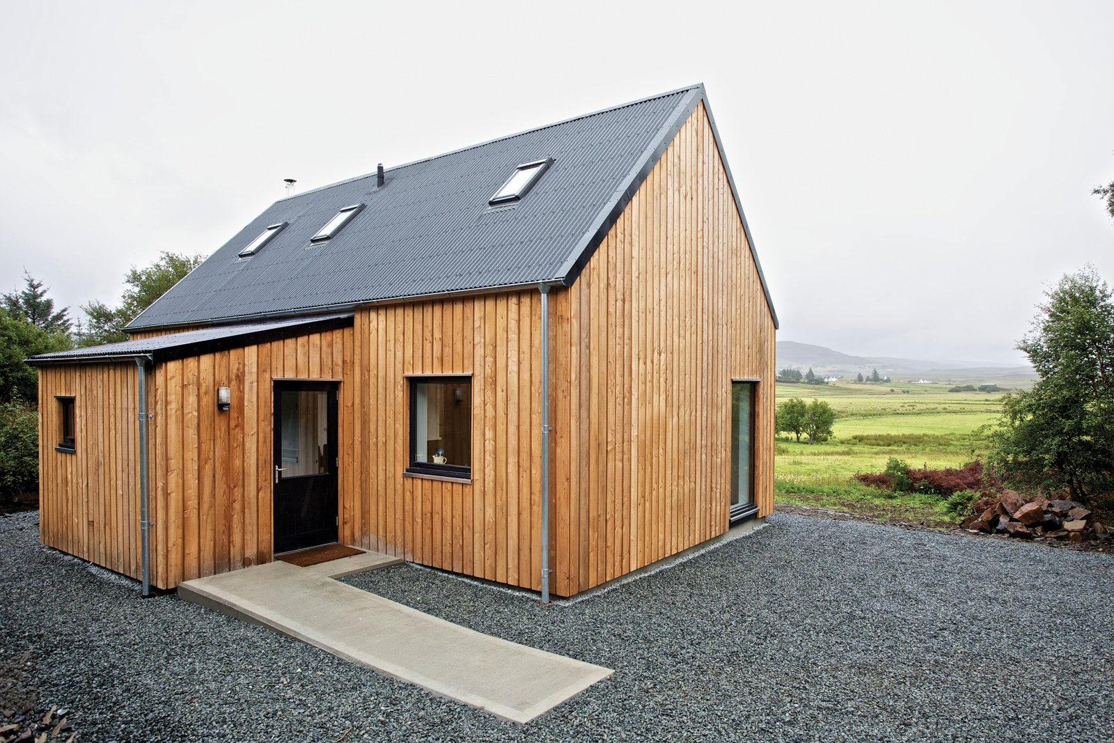 "Exterior, House Building Type, and Prefab Building Type This ""local prefab"" home on the Isle of Skye is made mostly from materials sourced in northern Scotland. The timber-framed model, meant to evoke the simple agrarian barns of the area, can be constructed on-site in as little as a day and is designed for affordability.  Photo 2 of 8 in 8 Inspirational Island Prefabs from Locally-Sourced Prefab Prototype in Scotland"