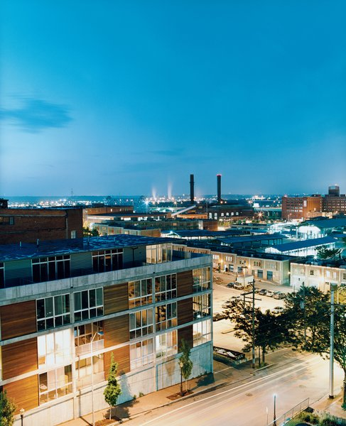 From across Delaware Street, the 5 Delaware lofts blend into their downtown surroundings. Just a block away, the stalls of the River Market, which gives the neighborhood its name, are visible in the background.  Photo 1 of 8 in Kansas City, MO