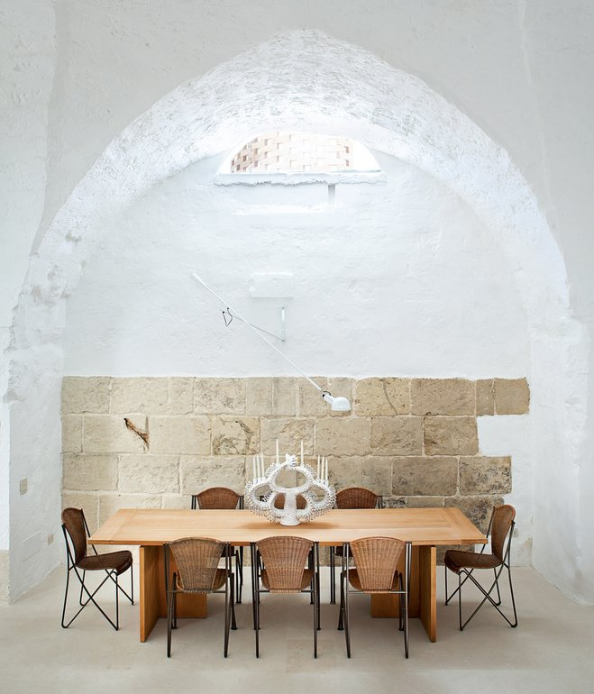 Dining Room, Concrete Floor, Table, and Chair Ludovica Serafini and Roberto Palomba, who work as Ludovica+Roberto Palomba, commissioned a dining table of their own design from Exteta and paired it with Abanica chairs by Oscar Tusquets for Driade.  Photo 9 of 41 in 50 Dashing Dining Rooms from Incredible Dining Rooms