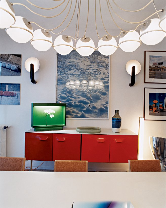 One of Krzentowski's favorite pieces is the Gino Sarfatti 2109/16 ceiling lamp, which hangs above the dining room table.  Photo 6 of 14 in Like a Kid in a Candy Store
