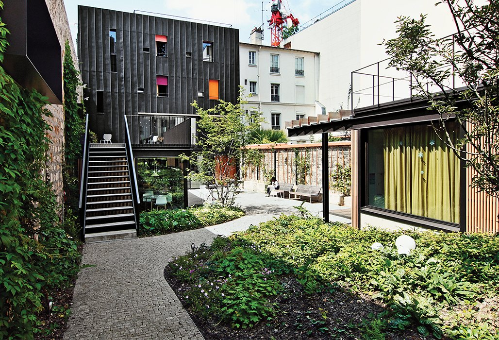 Outdoor, Back Yard, Hardscapes, Garden, Walkways, and Gardens Architect Damien Brambilla turned a run-down Paris apartment building into an open, bright adolescent group home with a landscaped garden.  Photo 9 of 10 in 10 Modern Renovations to Unique Homes in France from How California Style Influenced a Group Home in Paris
