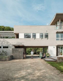 Resolution: 4 Architecture designed a Fishers Island home with warm cedar siding and white windows as a nod to the regional New England vernacular.