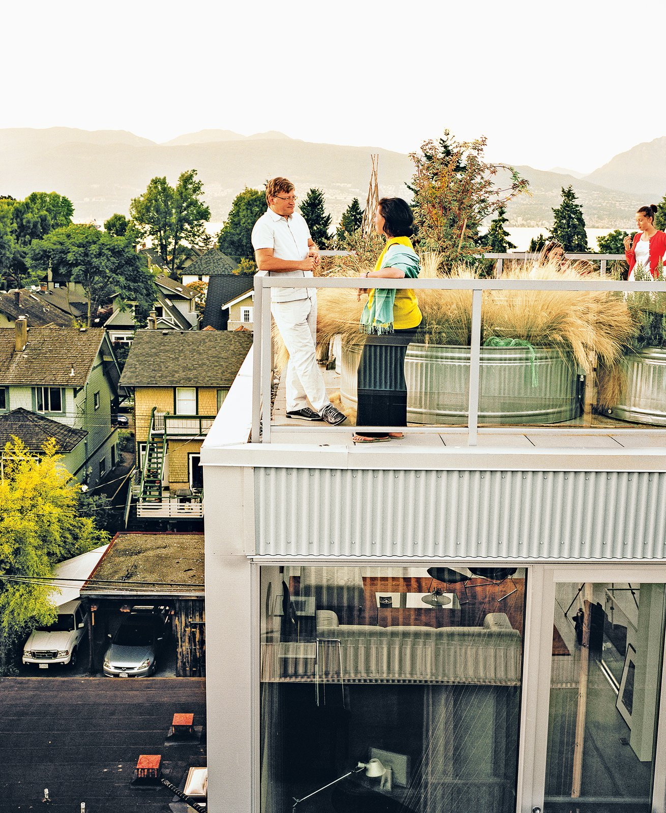 Each of the residences has outdoor space attached to it; the family's unit has a roof deck. In   lieu of a green roof is a galvanized tub filled with grasses—a collaboration between the architects   and landscape architecture firm space2place.  Photo 6 of 7 in A Modern Multiunit Prefab Prototype in Vancouver