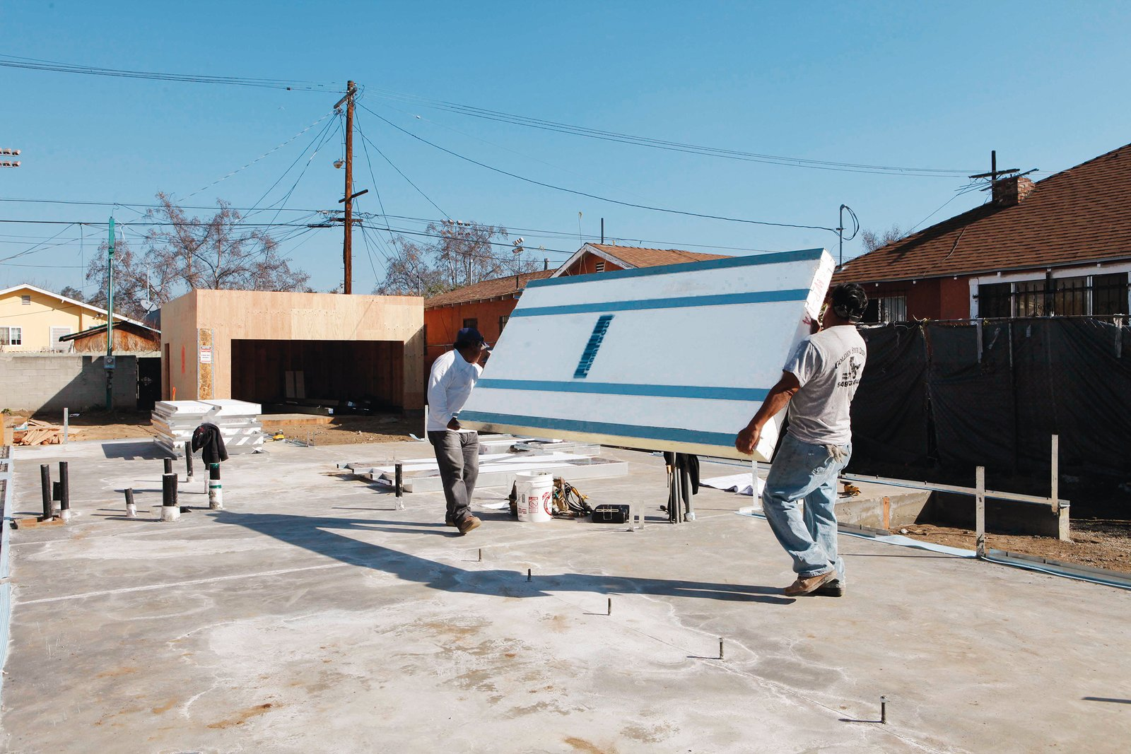 """""""There's no drilling or chopping,"""" says Erla Dögg Ingjaldsdóttir, cofounder of Minarc. """"It's   a very elegant way to build."""" Photos by Art Gray.  Photo 2 of 3 in An Innovative Net-Zero Prefab in Los Angeles"""