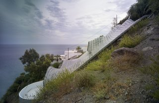 11 Hillside Homes That Feature a Balancing Act With Nature - Photo 5 of 10 - Aside from its dramatic appearance, this home's subterranean construction comes with an energy efficiency advantage: the surrounding soil is a constant 67 degrees, thereby helping to keep the interiors comfy year-round.