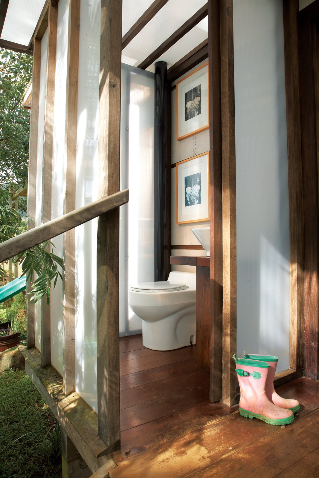 Bath Room Nearby, the bathroom includes a composting toilet and a Home Depot sink on a pedestal Chris made from chunks of found wood.  Photo 4 of 22 in Grateful Shed