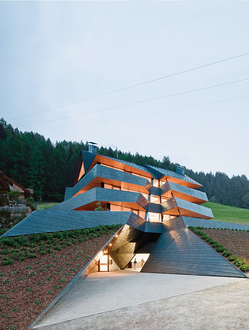 In the Dolomite mountains, an angular copper-clad apartment building echoes the topography of its site. Photos by Hertha Hurnaus  Photo 1 of 1 in An Angular Copper-Clad Apartment Building in Italy