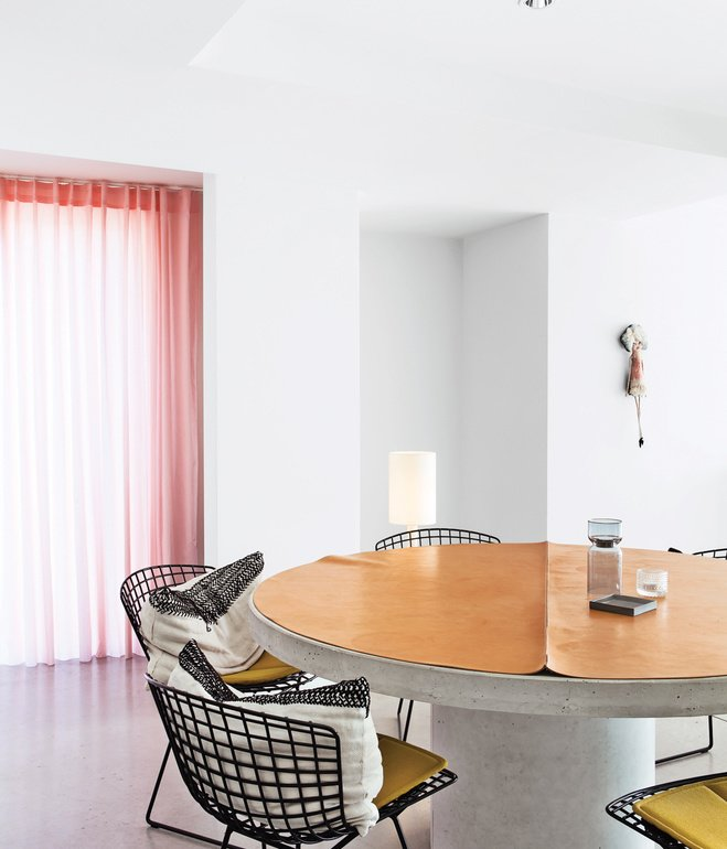 Dining Room, Chair, and Table A pair of interior architects with a years-in-the-making furniture collection recast an old Belgian factory as a playful family home.  Photo 7 of 41 in 50 Dashing Dining Rooms from Design Classic: Bertoia Seating Collection