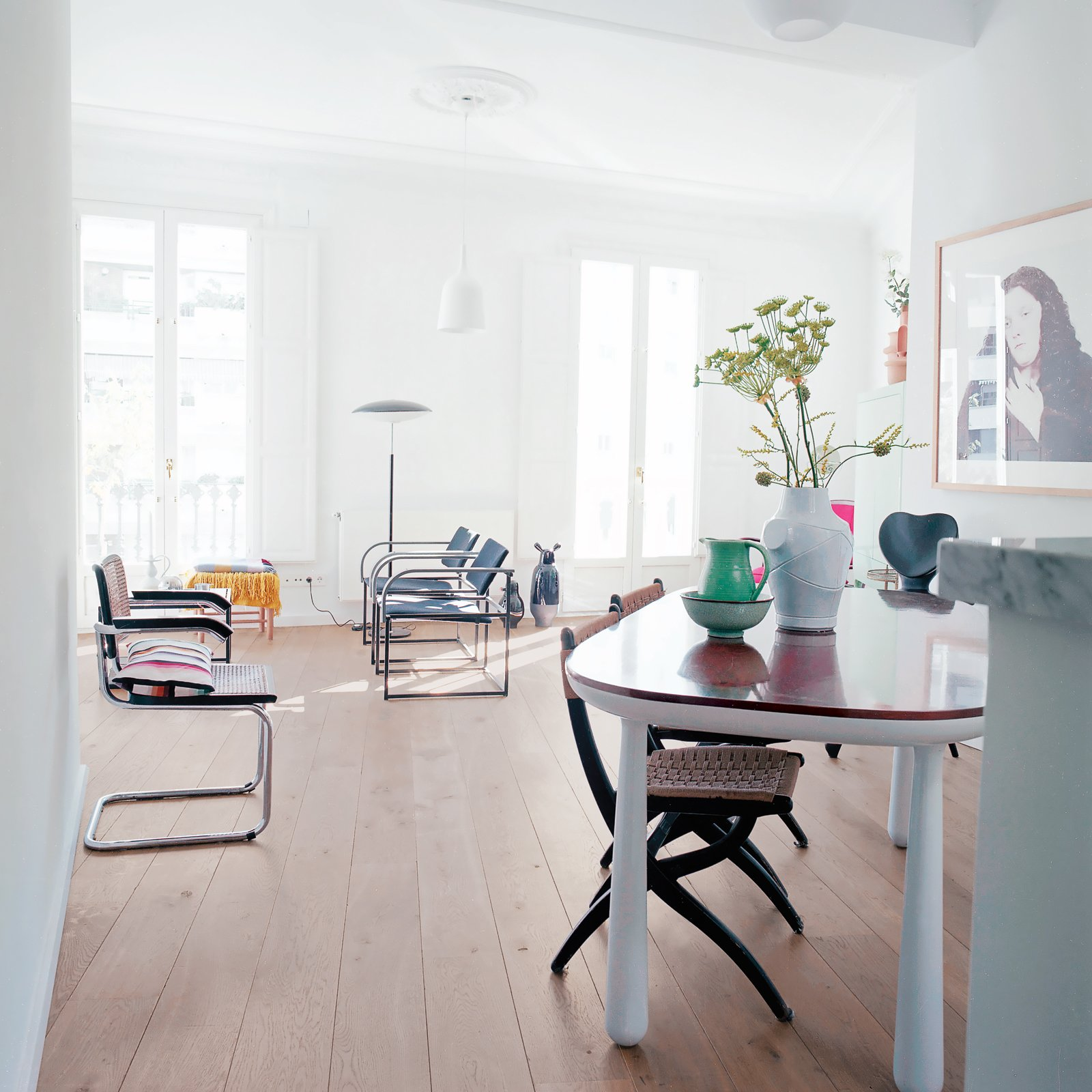 """The couple snapped up a 2,600-square-foot late-18th-century flat, which they've since filled with   vintage finds and Hayon's own   designs and prototypes. Tagged: Living Room, Chair, and Medium Hardwood Floor.  Photo 2 of 7 in """"A Home Should Never Feel Like a Hotel Lobby"""""""