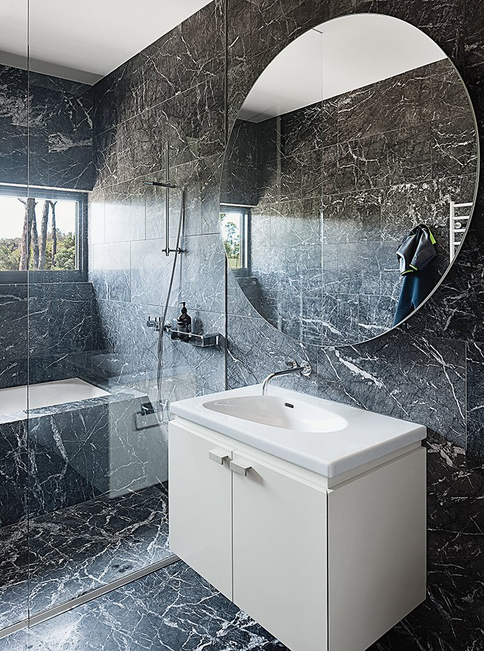Bath Room, Marble Counter, Marble Floor, Wall Mount Sink, Undermount Tub, Full Shower, Enclosed Shower, and Marble Wall The marble continues in a bathroom, which has a Palomba sink from Laufen.  Photo 7 of 8 in Living Simply on a Lush Australian Estate
