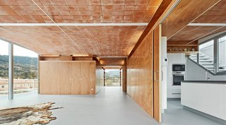 In the Catalonia region of Spain, architecture firm Fake Industries Architectural Agonism in concert with Aixopluc created a house that combines industrially manufactured components with a handmade, Catalonian vaulted-brick roof.