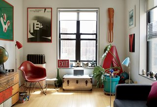 "Graphic designers Ned Drew and Brenda McManus have made their renovated Manhattan apartment a showcase for their collectibles, including a vintage Eames leg splint and a ""Wilhelm Tell"" poster by Armin Hofmann."