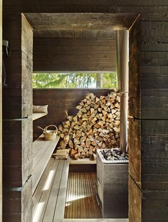 A traditional wood-burning stove fuels the earthy sauna in this Finnish home by Bengt Mattias Carlsson.