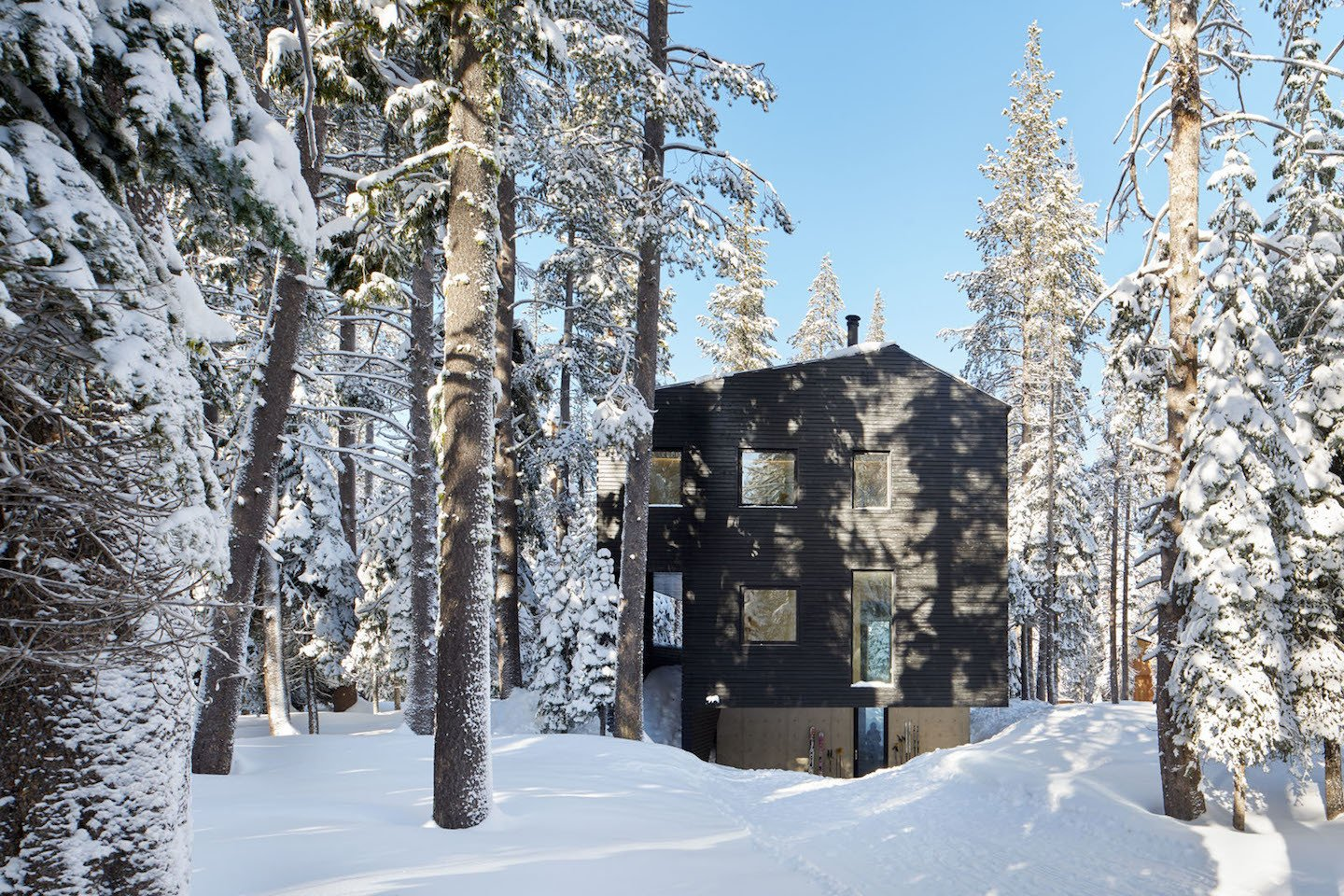 "Exterior, Cabin Building Type, Wood Siding Material, and House Building Type Construction during Lake Tahoe's snowy season posed the biggest building challenge. ""We shrink-wrapped the building, so the contractor could continue working through the cold of winter, sparing the expense of continuous snow removal, and limiting traces of the process on the landscape. Snowmobiles and sledges were used to bring workers and construction materials to the site."" Casper says.  Photo 96 of 101 in 101 Best Modern Cabins from Here's What Norse Mythology and Modern Architecture Have in Common"