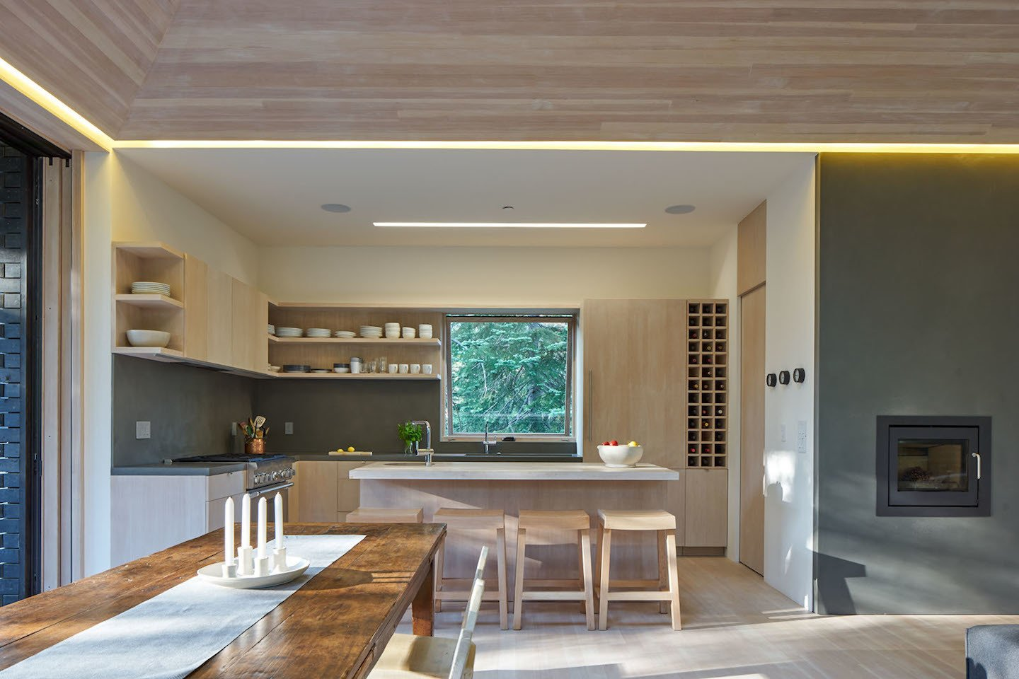 The open-plan kitchen serves the family's needs for easy entertaining. The four bar stools are also custom designed by Lexie and were built by Yvonne Mouser.  Photo 4 of 7 in Here's What Norse Mythology and Modern Architecture Have in Common